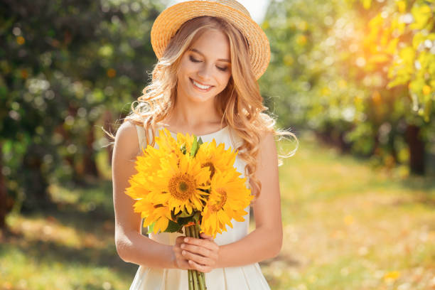 Young woman blonde hair summer style concept stock photo