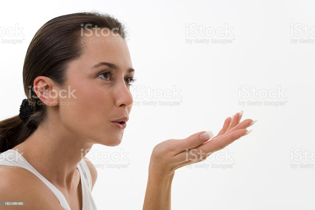 Young woman blowing a kiss off frame royalty-free stock photo
