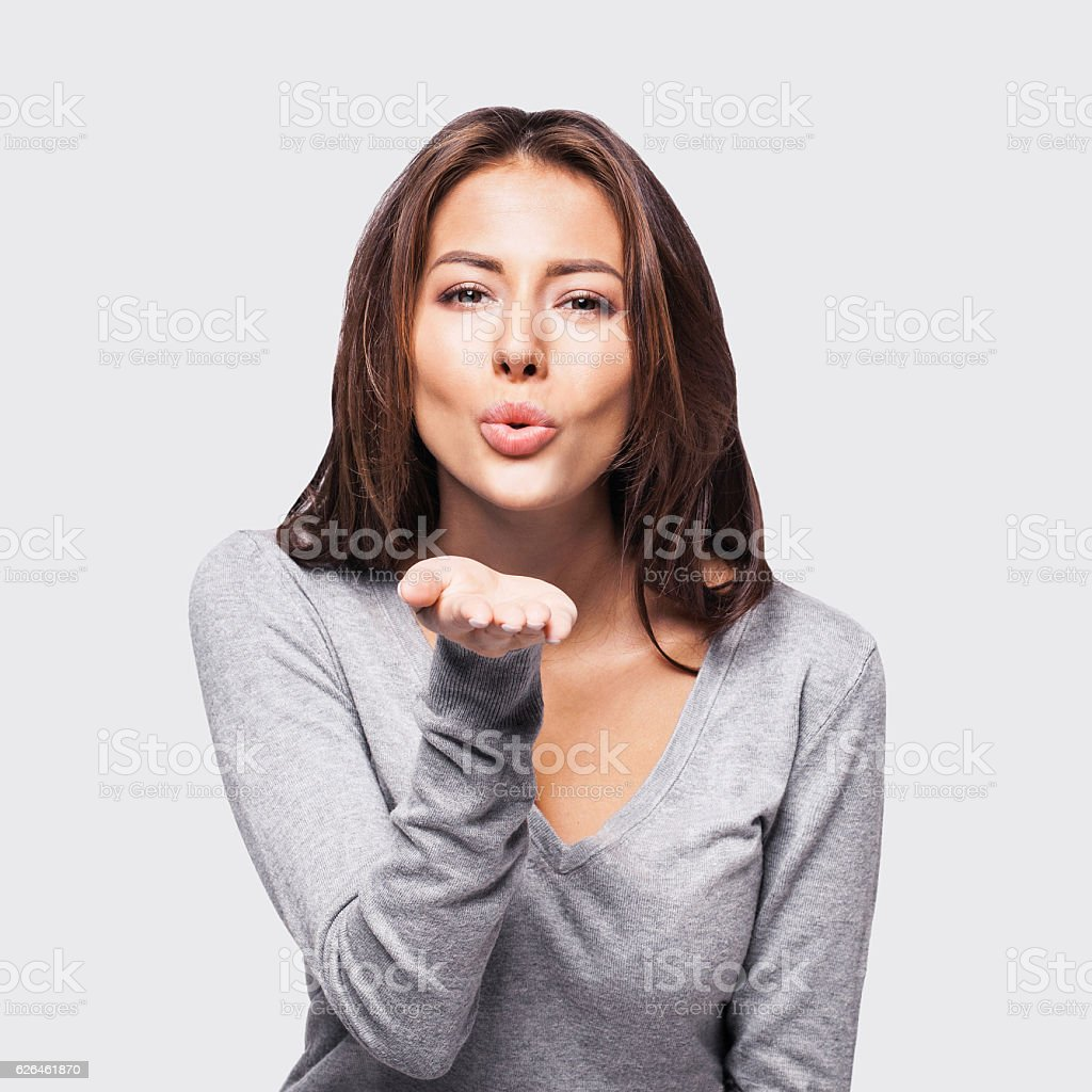 Young woman blowing a kiss stock photo
