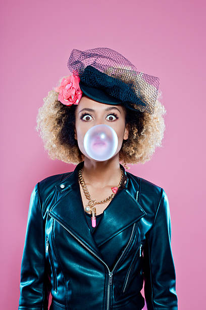 Young woman blowing bubble gum stock photo