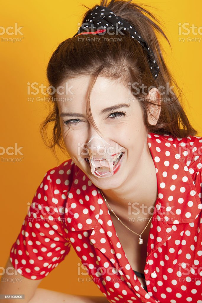 Young woman blowing bubblegum stock photo