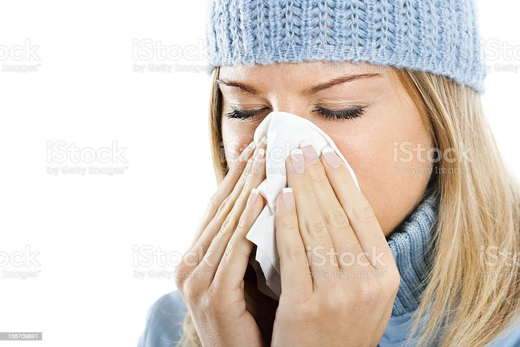 Young woman blowing into tissue royalty-free stock photo