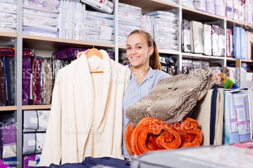 Young woman boasting numerous purchases stock photo