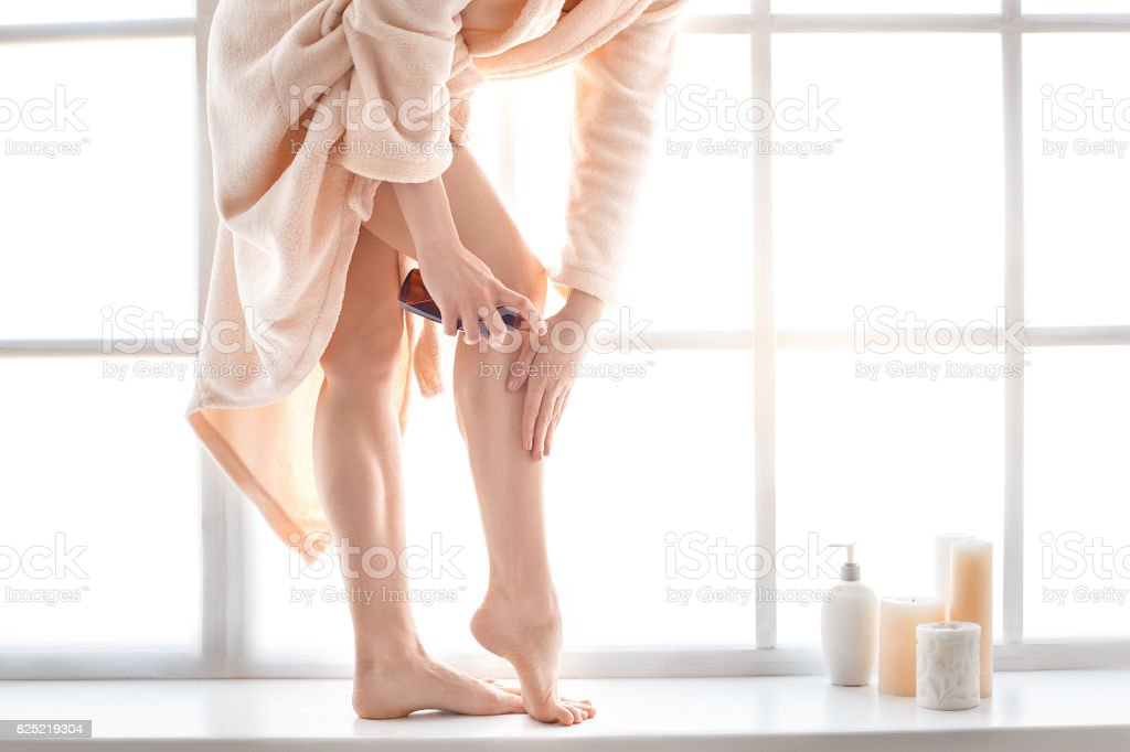 Young woman body care at home indoors stock photo