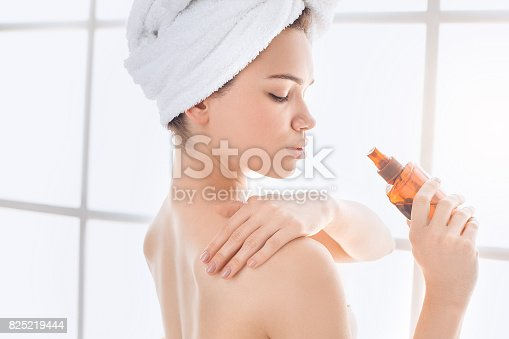 istock Young woman body care at home indoors 825219444
