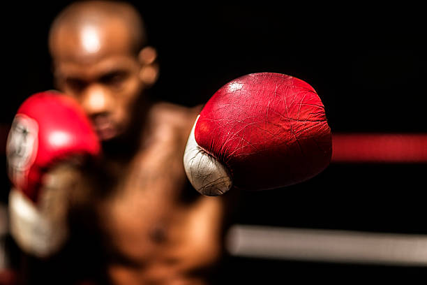 young woman boxer. - punching stock photos and pictures