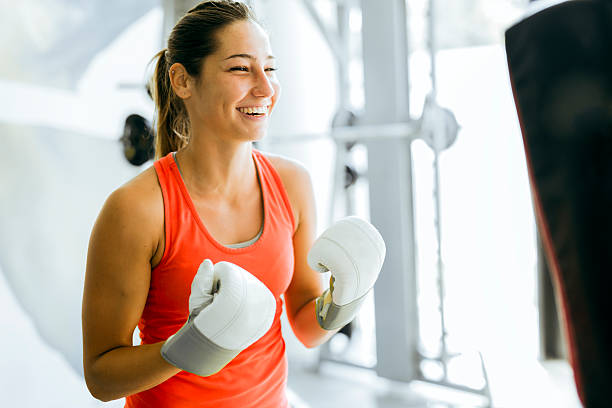 Young woman boxing and training stock photo