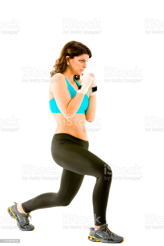 Young woman boxing during body combat fitness royalty-free stock photo