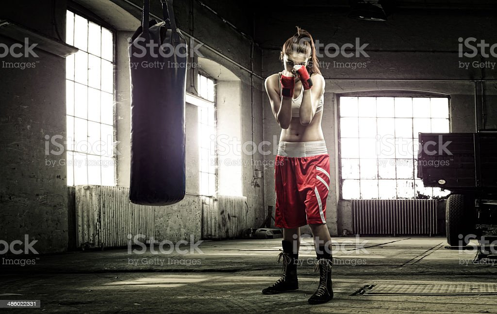 Young woman boxing workout in an old building stock photo