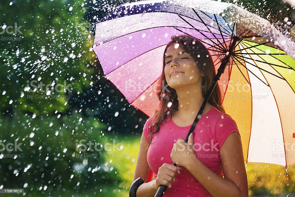 Young woman breathing fresh air during the spring rain royalty-free stock photo
