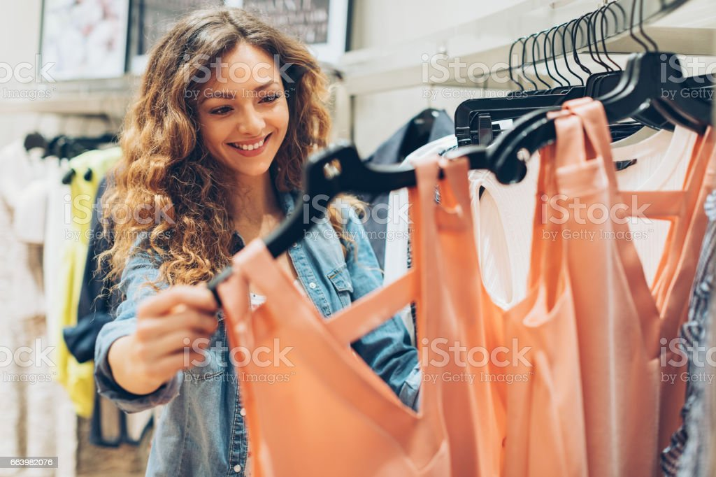Young woman browsing in the fashion store stock photo