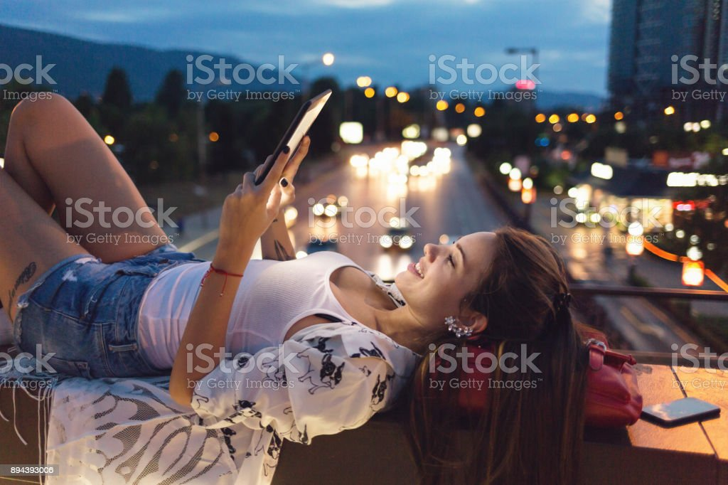 Young woman browsing on the tablet stock photo