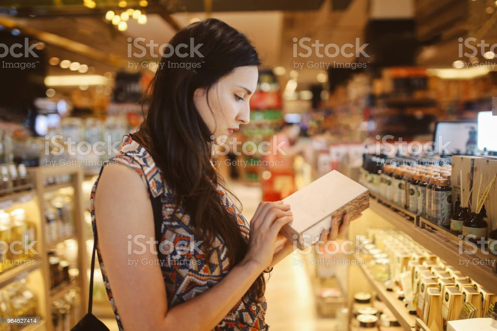 Young woman browsing through the stores in Bangkok shopping mall stock photo