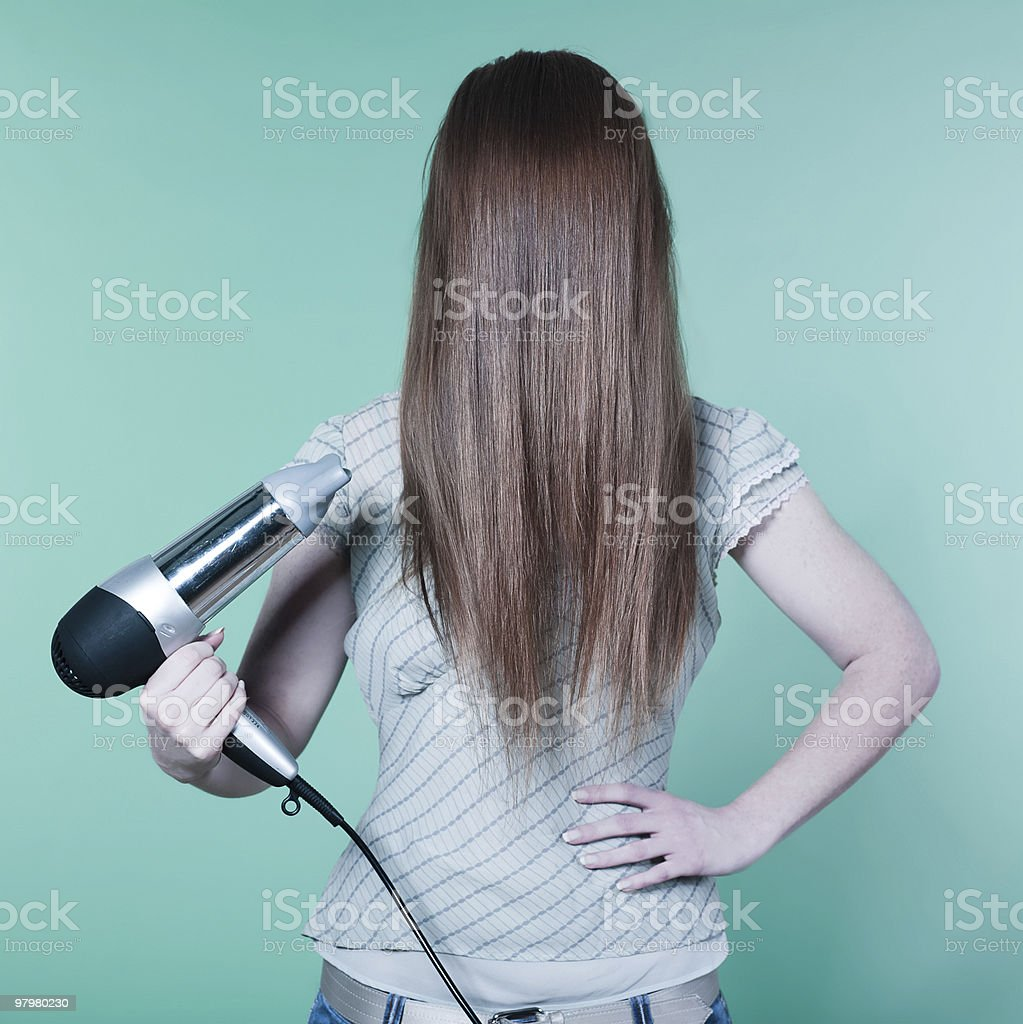 young woman brushing hair face hiding stock photo