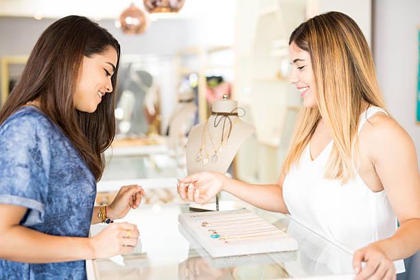 young woman buying a diamond ring - diamanten kaufen stock-fotos und bilder