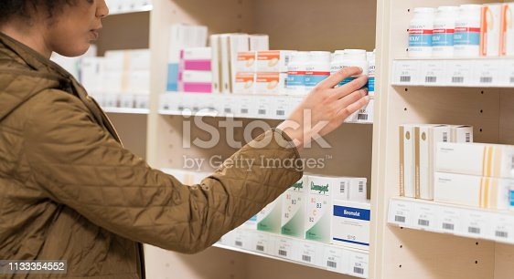 Young woman buying at pharmacy