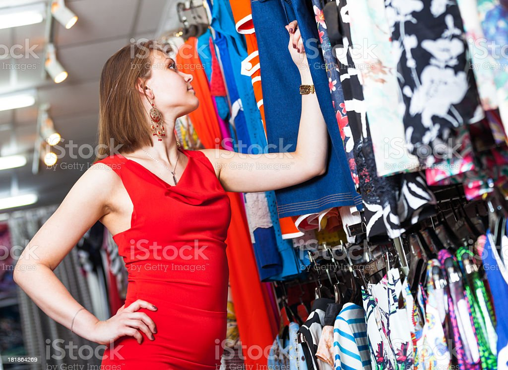 Young woman buying clothes in a boutique royalty-free stock photo