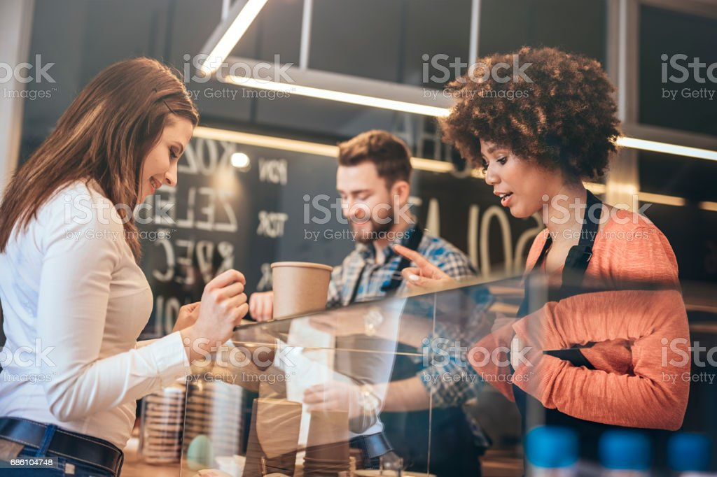 Young woman buying   food  at snack bar stock photo