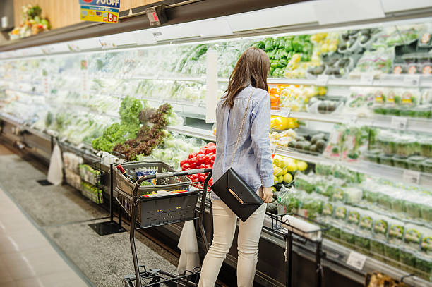 young woman buying grocery in supermarket - happy person buy appliances stock photos and pictures