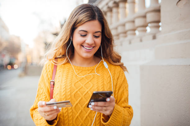 Young woman buying on the internet stock photo