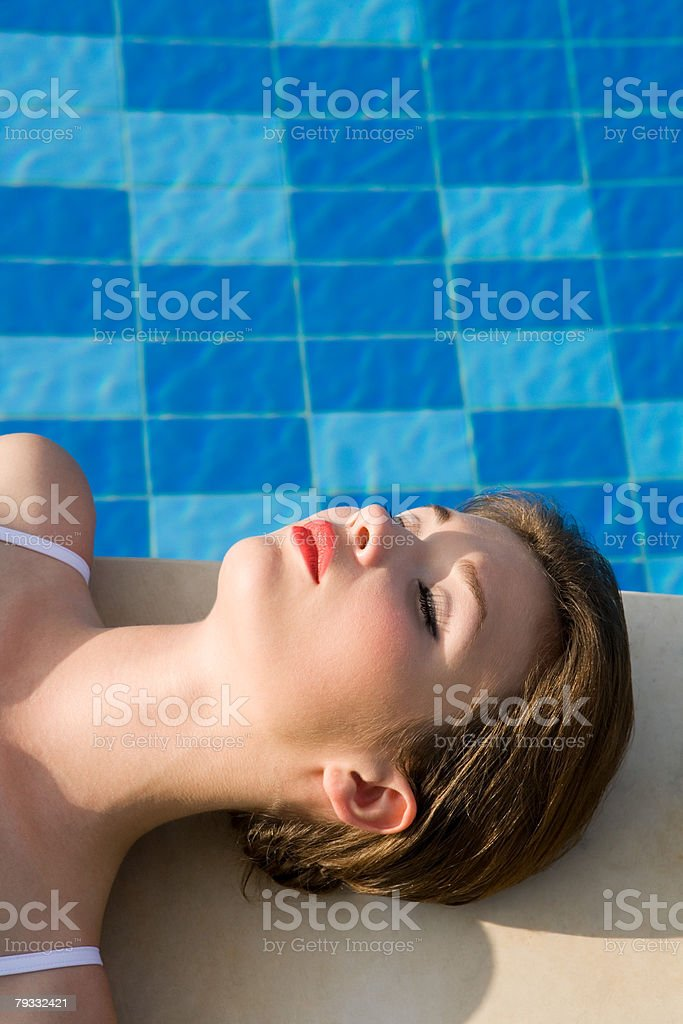Young woman by swimming pool 免版稅 stock photo