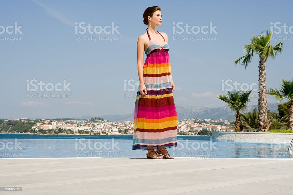 Young woman by swimming pool royalty-free stock photo