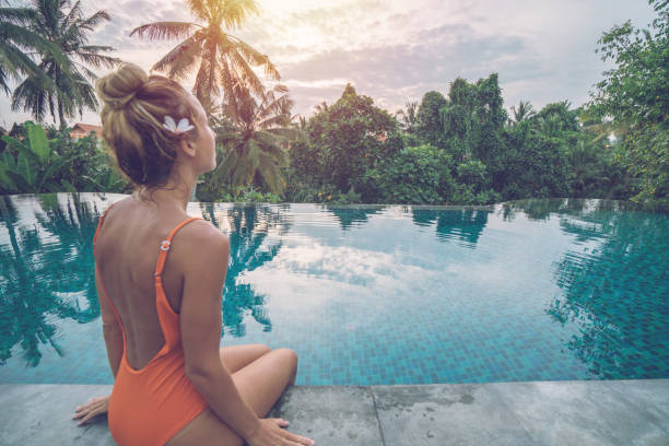 Young woman by the edge of an infinity pool ubud bali enjoying in picture id1028466102?b=1&k=6&m=1028466102&s=612x612&w=0&h=h91qtdtz3vys73 2kwsjaxx2bar zudqn6lydtuqbcw=