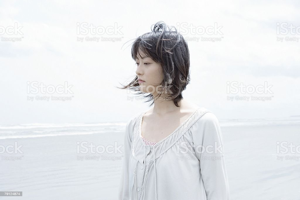 Young woman by the sea 免版稅 stock photo