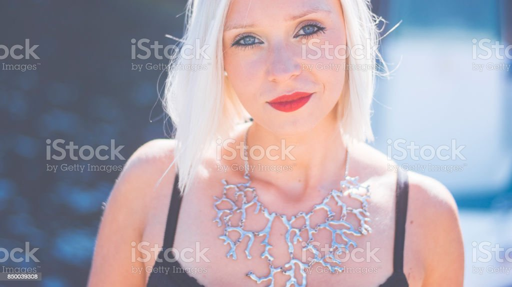 Young woman  by the sea stock photo