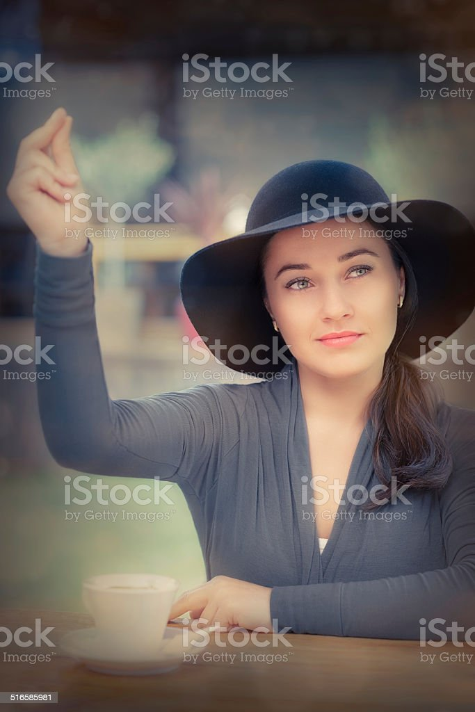Young Woman Calling a Waiter stock photo