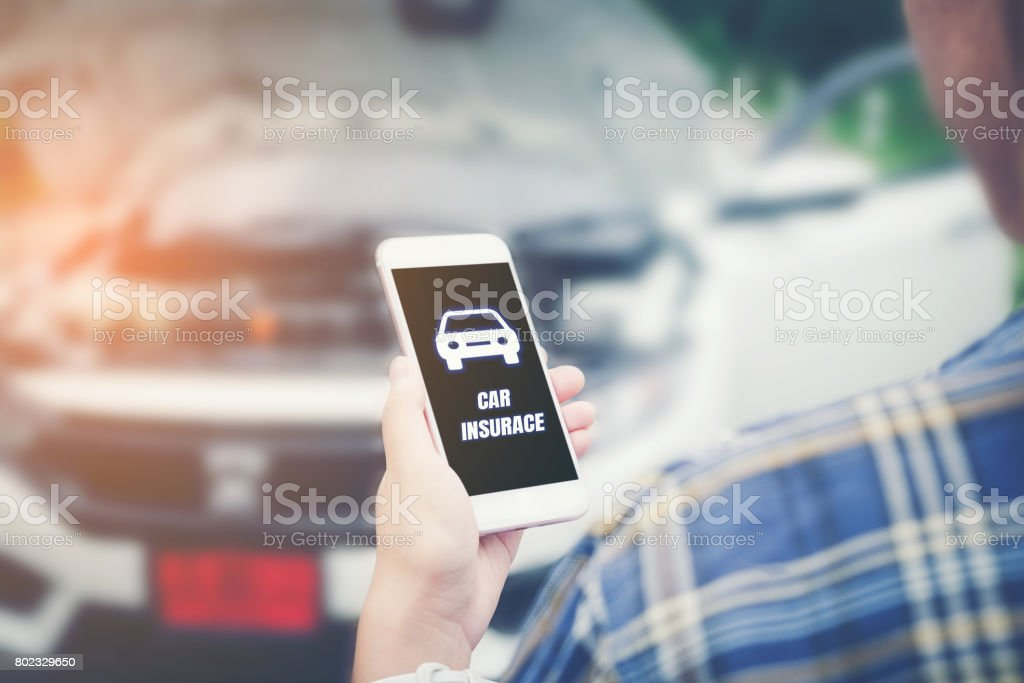 Young Woman calling for assistance after traffic accident car insurance stock photo