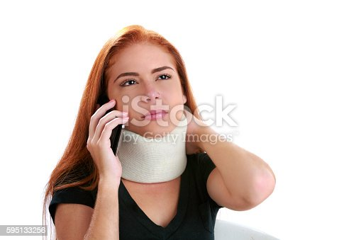 Insurance themes. Young woman calling insurance company due to neck injury in car accident whiplash