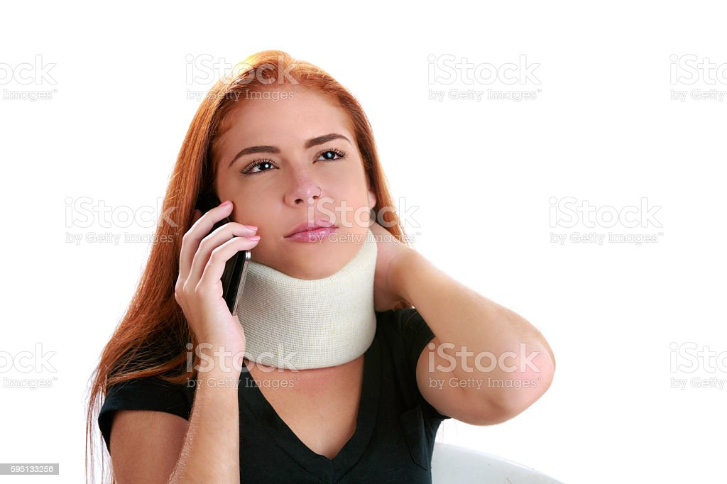 Young woman calling insurance company due to neck injury stock photo
