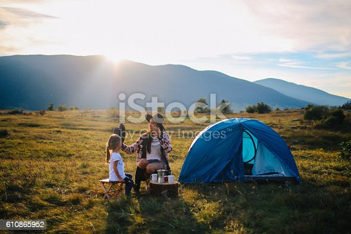 istock Young woman camping with a baby girl 610865952
