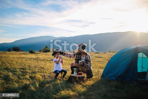 istock Young woman camping with a baby girl 610866012