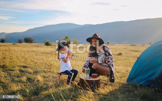 istock Young woman camping with a baby girl 610866142