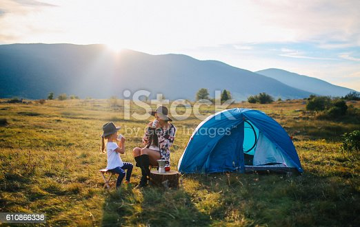 istock Young woman camping with a baby girl 610866338