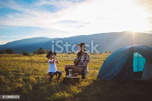 istock Young woman camping with a baby girl 610866424
