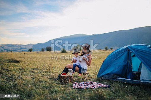istock Young woman camping with a baby girl 610866702