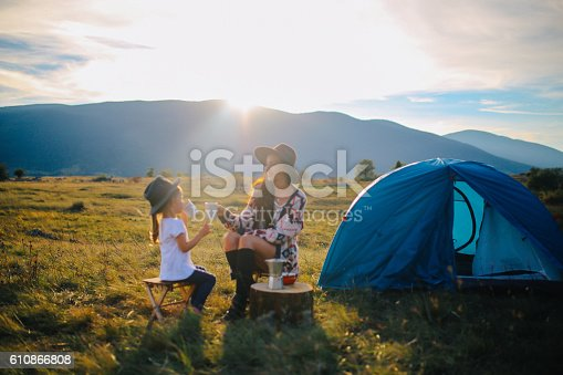 istock Young woman camping with a baby girl 610866808