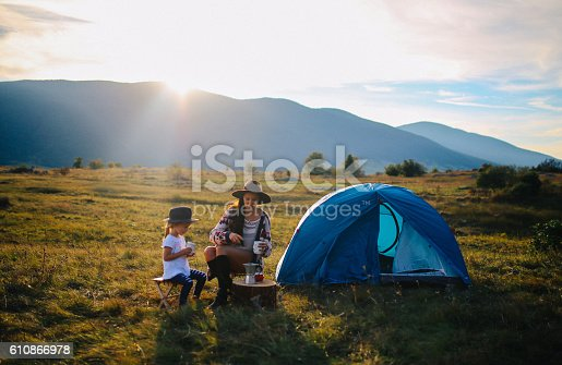 istock Young woman camping with a baby girl 610866978