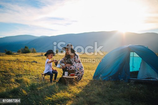 istock Young woman camping with a baby girl 610867054
