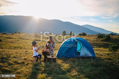istock Young woman camping with a baby girl 610867198