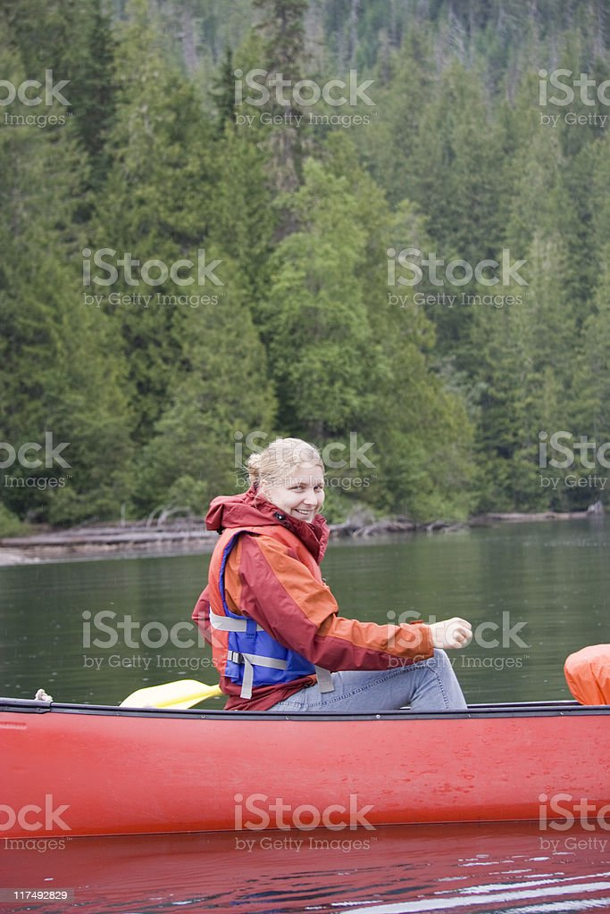 Young woman canoeing royalty-free stock photo