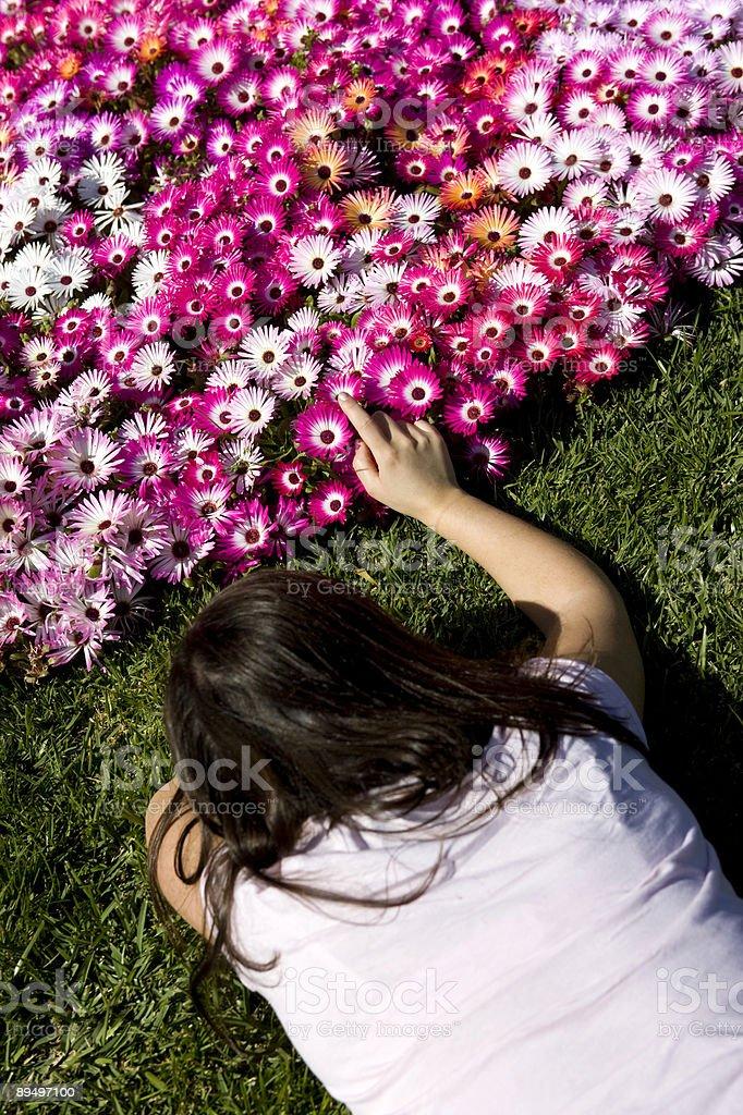 young woman caressing flower bouquet royaltyfri bildbanksbilder