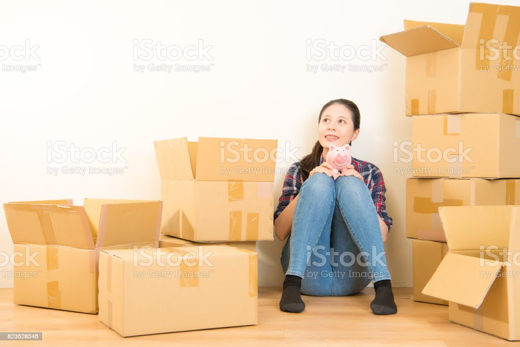 young woman caressing her piggy bank stock photo