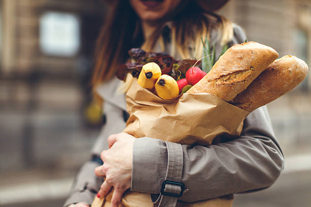 Young woman carrying groceries stock photo