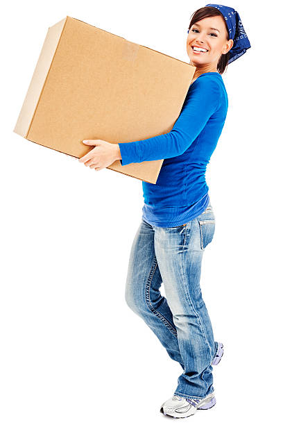 Young Woman Carrying Large Cardboard Moving Box stock photo