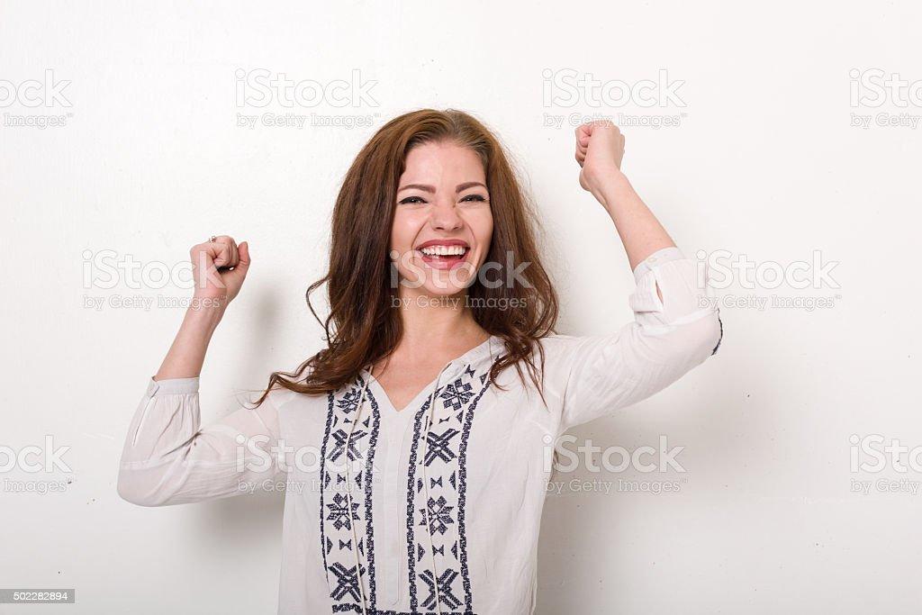 Young woman celebrates success stock photo