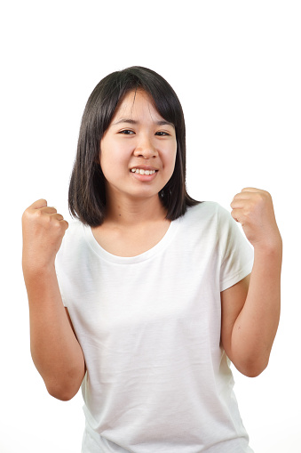 500150419 istock photo Young woman celebrating 531047323